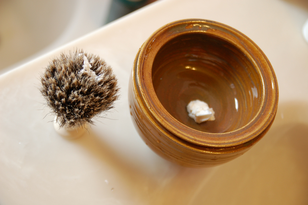 hot water in the bottom bowl, a small dollop of shaving cream in the top bowl...